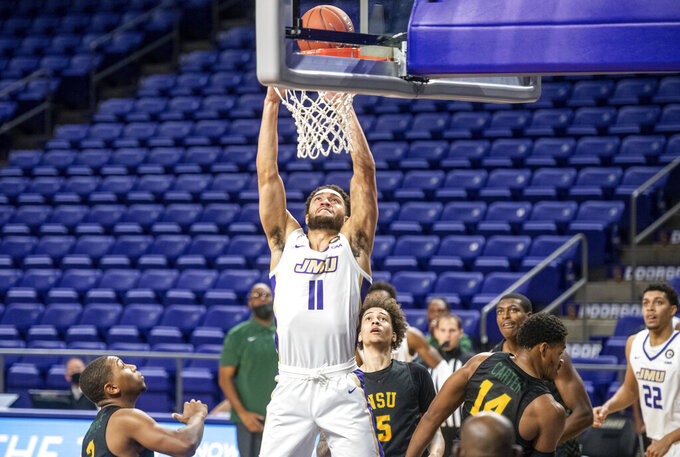 James Madison forward Zach Jacobs (11) finds a gap in Norfolk State to make a basket during the first half of an NCAA basketball game in Harrisonburg, Va., Friday, Nov. 27, 2020. (Daniel Lin/Daily News-Record via AP)