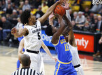 UCLA guard Kris Wilkes, center, battles to shoot as Colorado guards D'Shawn Schwartz, left, and Tyler Bey defend in the first half of an NCAA college basketball game Thursday, March 7, 2019, in Boulder, Colo. (AP Photo/David Zalubowski)