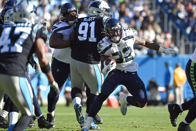 Seattle Seahawks running back Chris Carson (32) runs against the Carolina Panthers during the first half of an NFL football game in Charlotte, N.C., Sunday, Dec. 15, 2019. (AP Photo/Mike McCarn)