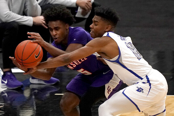 Evansville's Shamar Givance (5) and Indiana State's Julian Larry (10) chase a loose ball during the second half of an NCAA college basketball game in the quarterfinal round of the Missouri Valley Conference men's tournament Friday, March 5, 2021, in St. Louis. (AP Photo/Jeff Roberson)