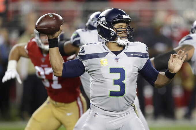 Seattle Seahawks quarterback Russell Wilson (3) passes against the San Francisco 49ers during the first half of an NFL football game in Santa Clara, Calif., Monday, Nov. 11, 2019. (AP Photo/Ben Margot)