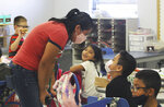 This Sept. 3, 2021, photo shows Priscila Lopez, a parent of three students at MacArthur Community Elementary School in Las Cruces, N.M., watching a first grade classroom while the teacher took a lunch break. Lopez was hired in mid-August as a lunch monitor. (Miranda Cyr/Las Cruces Sun-News via AP)
