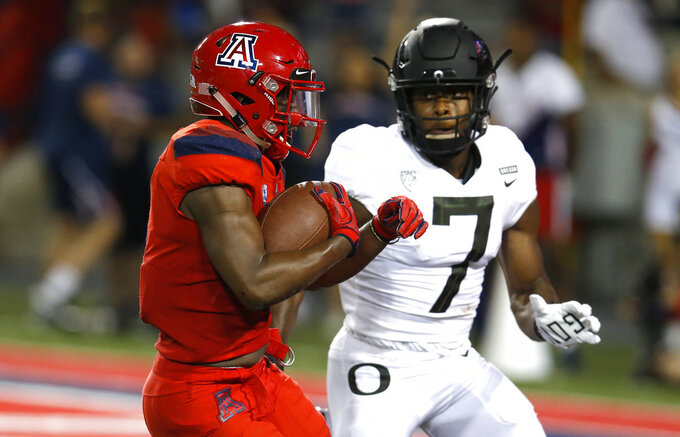 Arizona wide receiver Shun Brown scores a touchdown in front of Oregon safety Ugochukwu Amadi (7) in the second half during an NCAA college football game, Saturday, Oct. 27, 2018, in Tucson, Ariz. (AP Photo/Rick Scuteri)