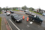 Vehicles are seen in traffic at the merger between Sandy Hollow Road and County Road 39 near the site of the U.S. Open Golf Championship, Wednesday, June 13, 2018, in Southampton, N.Y. (AP Photo/Julio Cortez)