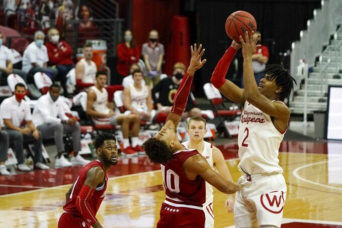 Wisconsin's Aleem Ford shoots over Indiana's Rob Phinisee during the first half of an NCAA college basketball game Thursday, Jan. 7, 2021, in Madison, Wis. (AP Photo/Morry Gash)