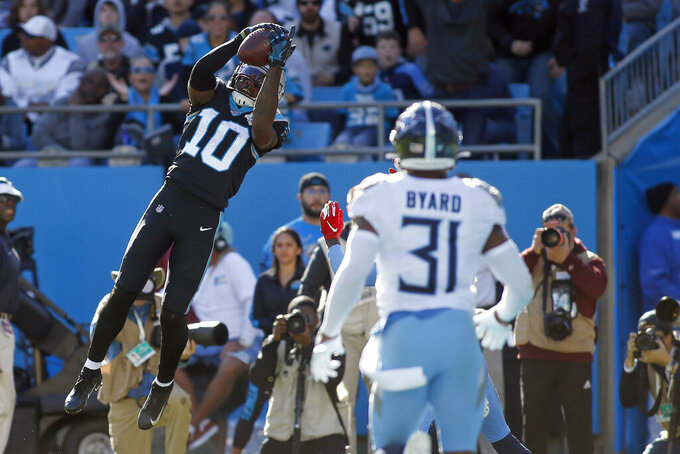 Carolina Panthers wide receiver Curtis Samuel (10) catches a touchdown pass in the end zone while Tennessee Titans free safety Kevin Byard (31) looks on during the first half of an NFL football game in Charlotte, N.C., Sunday, Nov. 3, 2019. (AP Photo/Brian Blanco)