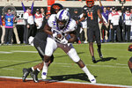 TCU tight end Pro Wells (81) scores in front of Oklahoma State safety Tanner McCalister (2) in the first half of an NCAA college football game in Stillwater, Okla., Saturday, Nov. 2, 2019. (AP Photo/Sue Ogrocki)
