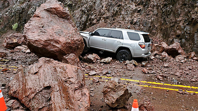This photo provided by The Oregon Department of Transportation shows two enormous boulders that fell onto Highway 62, almost crushing a car outside of Prospect, Ore., Tuesday, Jan. 28, 2020. Rockslides triggered by unrelenting rain have closed local roads and highways around Oregon, including a highway near Crater Lake National Park that was closed for hours Tuesday after two boulders the size of a small living room crashed down, narrowly missing the passing car. (The Oregon Department of Transportation via AP)