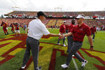 Iowa State head coach Matt Campbell, left, meets with Oklahoma head coach Lincoln Riley, right, before an NCAA college football game, Saturday, Sept. 15, 2018, in Ames, Iowa. (AP Photo/Matthew Putney)