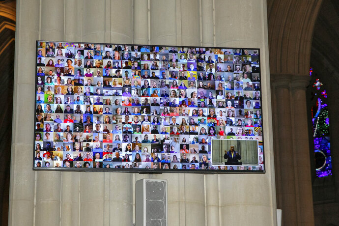 File-This April 12, 2020, file photo shows participants in the Episcopal Church Virtual Choir  in a collage during a live streamed Easter Sunday service at the National Cathedral, in Washington. Congregational singing is considered essential for many churches. But, in the midst of the coronavirus, religious leaders have received jarring predictions from scientists well-versed in virology as well as vocal practices. Clergy are considering what to do with the results of those reports. (AP Photo/Jacquelyn Martin, File)