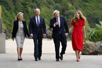 President Joe Biden and first lady Jill Biden are greeted and walk with British Prime Minister Boris Johnson and his wife Carrie Johnson, ahead of the G-7 summit, Thursday, June 10, 2021, in Carbis Bay, England. (AP Photo/Patrick Semansky)