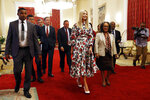 White House senior adviser Ivanka Trump, center, walks with Ethiopia's President Sahle-Work Zewde, center right, after their meeting at the Presidential Palace in Addis Ababa, Ethiopia on Monday April 15, 2019. Ivanka Trump is on a four-day trip to Ethiopia and Ivory Coast on behalf of a White House project intended to boost 50 million women in developing countries by 2025. (AP Photo/Jacquelyn Martin)