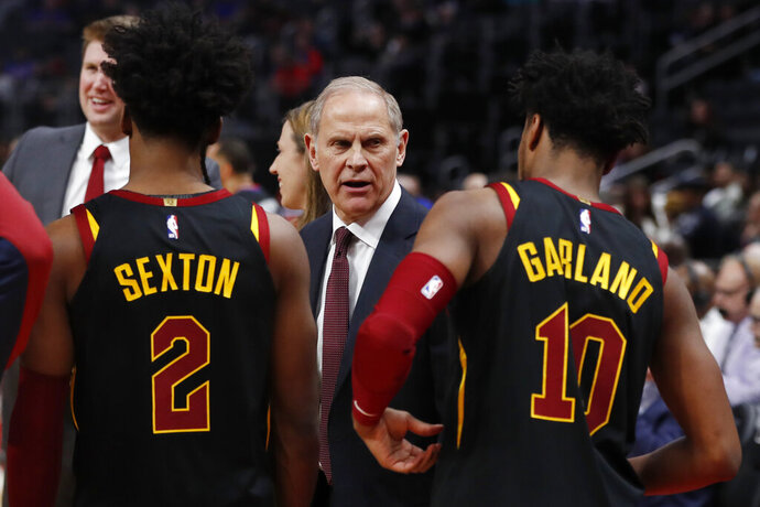 Cleveland Cavaliers coach John Beilein talks with guards Collin Sexton (2) and Darius Garland (10) during the first half of an NBA basketball game against the Detroit Pistons, Thursday, Jan. 9, 2020, in Detroit. (AP Photo/Carlos Osorio)