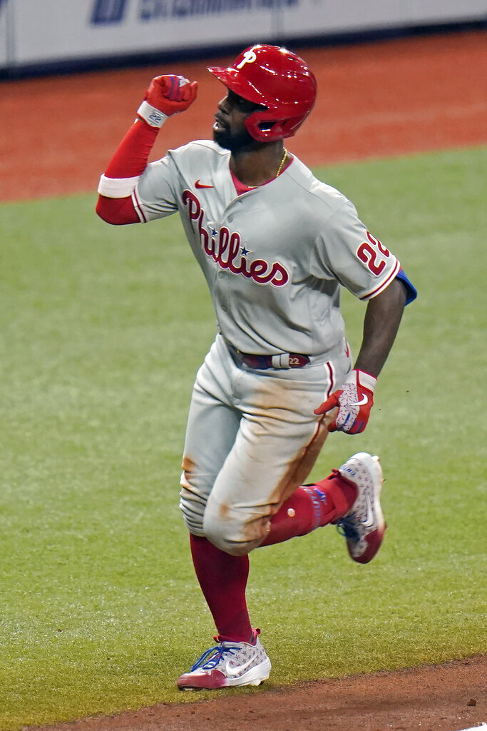 Philadelphia Phillies' Andrew McCutchen (22) celebrates his solo home run off Tampa Bay Rays relief pitcher Peter Fairbanks during the fifth inning of a baseball game Saturday, Sept. 26, 2020, in St. Petersburg, Fla. (AP Photo/Chris O'Meara)
