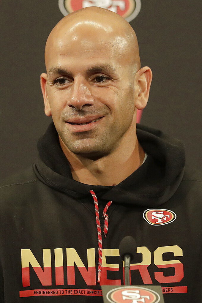 FILE - In this May 30, 2018, file photo, San Francisco 49ers defensive coordinator Robert Saleh speaks to reporters after a practice at the team's NFL football training facility, in Santa Clara, Calif. Green Bay Packers coach Matt Lafleur considers Saleh one of his best friends. When Green Bay coach Matt LaFleur started preparing to face San Francisco's stellar defense, he sent out a text message trying to get some inside information. (AP Photo/Jeff Chiu, File)