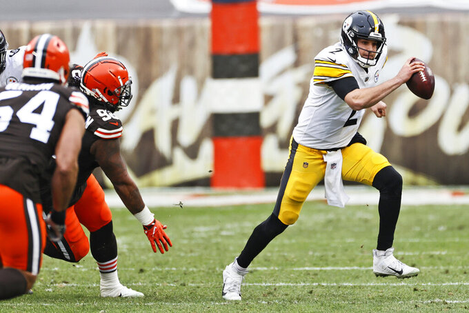 Pittsburgh Steelers quarterback Mason Rudolph (2) scrambles during the first half of an NFL football game against the Cleveland Browns, Sunday, Jan. 3, 2021, in Cleveland. (AP Photo/Ron Schwane)