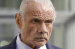 "FILE - In this Nov. 2, 2015, file photo, former professional wrestler Jimmy ""Superfly"" Snuka leaves after his formal arraignment at the Lehigh County Courthouse in Allentown, Pa. Snuka is among dozens of former pro wrestlers, named as plaintiffs in lawsuits charging that World Wrestling Entertainment failed to protect them from repeated head injuries, who are taking their case to the U.S. Supreme Court. (Michael Kubel/The Morning Call via AP, File)"