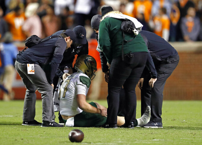 UAB quarterback Tyler Johnston III (17) is attended to after being injured in the second half of an NCAA college football game against Tennessee, Saturday, Nov. 2, 2019, in Knoxville, Tenn. (AP Photo/Wade Payne)