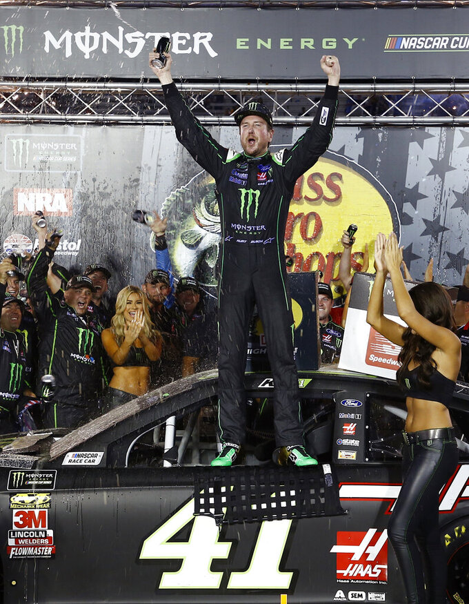 FILE - In this Aug. 18, 2018, file photo, Kurt Busch celebrates after winning a NASCAR Cup Series auto race, in Bristol, Tenn. Kurt Busch arrived at Phoenix this weekend feeling like he was holding a full house. The Las Vegas native is coming off a second consecutive top-five run, this time at his home track, and felt as if his Chip Ganassi Racing team _ and their Chevrolet power plants _ were finally catching up to the Ford and Toyota teams that have dominated the early part of the Cup season. To top it off, his No. 1 team announced Friday, March 8, 2019,  a new sponsorship deal with Global Poker, one of the world's leading online gaming sites _ no small news when motorsports backing is hard to find.(AP Photo/Wade Payne, File)