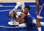 New York Knicks center Taj Gibson, left, and Atlanta Hawks forward John Collins (20) fight for a loose ball during the third quarter of Game 5 of an NBA basketball first-round playoff series Wednesday, June 2, 2021, in New York. (Wendell Cruz/Pool Photo via AP)