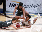 California forward Andre Kelly (22) battles for the ball against Washington State's Aljaz Kunc (4) and Dishon Jackson (21) during the first half of an NCAA college basketball game, Thursday, Jan. 7, 2021, in Berkeley, Calif. (AP Photo/Tony Avelar)