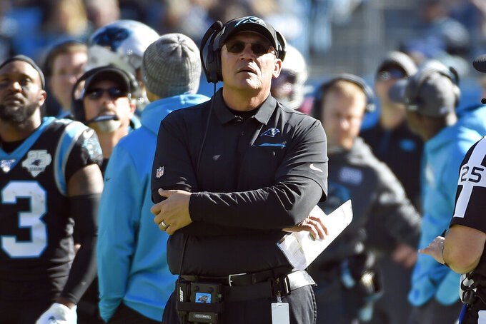 Carolina Panthers head coach Ron Rivera looks on during the first half of an NFL football game against the Tennessee Titans in Charlotte, N.C., Sunday, Nov. 3, 2019. (AP Photo/Mike McCarn)