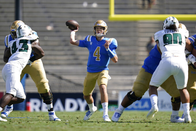 UCLA quarterback Ethan Garbers (4) throws a pass during the second half of an NCAA college football game against Hawaii Saturday, Aug. 28, 2021, in Pasadena, Calif. (AP Photo/Ashley Landis)