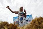 Democratic presidential candidate Sen. Kirsten Gillibrand, D-N.Y., speaks at the Iowa State Fair, Saturday, Aug. 10, 2019, in Des Moines, Iowa. (AP Photo/John Locher)