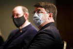 Secretary of Veterans Affairs Richard Wilkie, right, next to Under Secretary of Defense for Personnel and Readiness Matthew Donovan, left, wear protective masks against COVID-19, listen during a program to raise awareness on the risks of veterans suicide, Tuesday, July 7, 2020, at the National Press Club in Washington. (AP Photo/Jacquelyn Martin)
