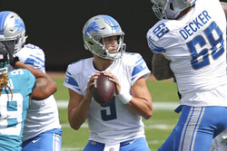 Detroit Lions quarterback Matthew Stafford (9) looks for a receiver during the first half of an NFL football game against the Jacksonville Jaguars, Sunday, Oct. 18, 2020, in Jacksonville, Fla. (AP Photo/Stephen B. Morton)
