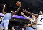 Columbia forward Ike Nweke (22) rebounds a ball against Northwestern center Dererk Pardon, right, and forward Pete Nance during the second half of an NCAA college basketball game Sunday, Dec. 30, 2018, in Evanston, Ill. Northwestern won 75-54. (AP Photo/Nam Y. Huh)