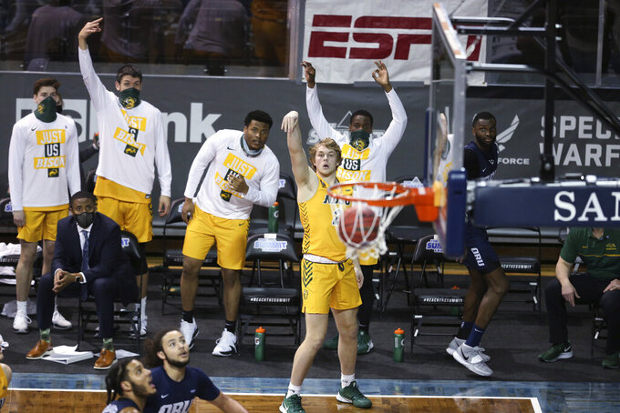 North Dakota State guard Jaxon Knotek (2) watches his 3-point shot go in against Oral Roberts during an NCAA college basketball game for the  Summit League men's tournament championship Tuesday, March 9, 2021, in Sioux Falls, S.D. (AP Photo/Josh Jurgens)