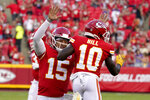 Kansas City Chiefs quarterback Patrick Mahomes (15) celebrates after throwing a touchdown pass to wide receiver Tyreek Hill (10) during the first half of an NFL football game against the Minnesota Vikings Friday, Aug. 27, 2021, in Kansas City, Mo. (AP Photo/Ed Zurga)