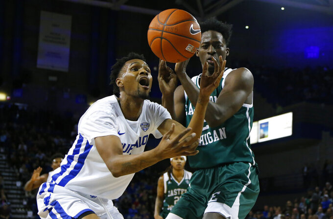 Buffalo forward Montell McRae (1) and Eastern Michigan center James Thompson IV fight for a loose ball during the first half of an NCAA college basketball game, Friday, Jan. 18, 2019, in Buffalo N.Y. (AP Photo/Jeffrey T. Barnes)