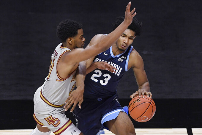 Villanova's Jermaine Samuels dribbles around Boston College's Wynston Tabbs, left, in the first half of an NCAA college basketball game, Wednesday, Nov. 25, 2020, in Uncasville, Conn. (AP Photo/Jessica Hill)