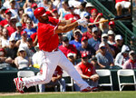 Los Angles Angels; Albert Pujols follow through on an RBI-double against the Cincinnati Reds during the first inning of a spring training baseball game Monday, March 12, 2018, in Tempe, Ariz. (AP Photo/Matt York)