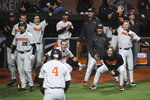 Oregon State players celebrate after scoring two runs on a hit by Adley Rutschman in the ninth inning during an NCAA college baseball tournament super regional game against Minesota Saturday, June 9, in Corvallis, Ore. (Amanda Loman/Albany Democrat-Herald via AP)