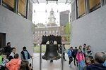 FILE - In this May 5, 2016, file photo, people file past the Liberty Bell in Independence Hall in Philadelphia. The coronavirus pandemic in 2020 not only upended the tourism industry, but how states, cities and attractions market themselves as summer travel destinations. (AP Photo/Matt Rourke, File)