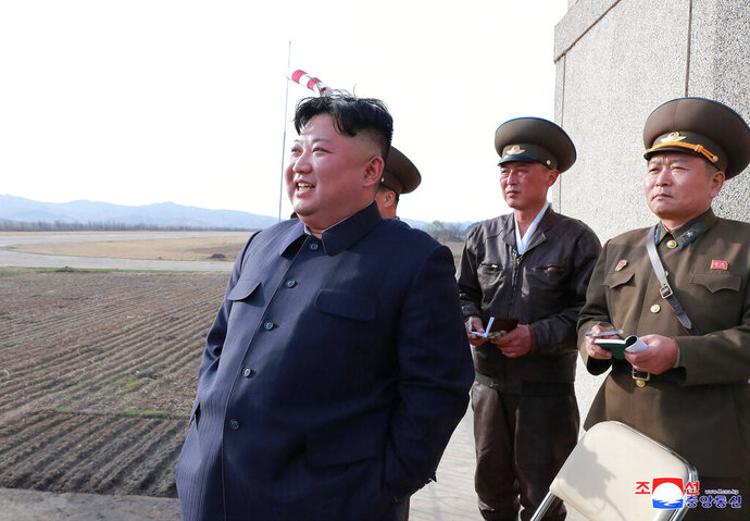 "In this Tuesday, April 16, 2019, photo provided by the North Korean government, North Korean leader Kim Jong Un inspects fighter combat readiness of Unit 1017 of the Air and Anti-aircraft Force of the Korean People's Army, in an unknown location in North Korea. Kim is cautiously turning up the heat after his unsuccessful summit with U.S. President Trump in Hanoi two months ago. Returning to military optics for the first time in five months, Kim paid a surprise visit to the Air Force base and followed that up the next day by supervising the test of what the North's official media described ominously - but ambiguously, and without any photos or video - as a new type of ""tactical guided weapon."" Independent journalists were not given access to cover the event depicted in this image distributed by the North Korean government. The content of this image is as provided and cannot be independently verified. Korean language watermark on image as provided by source reads:"