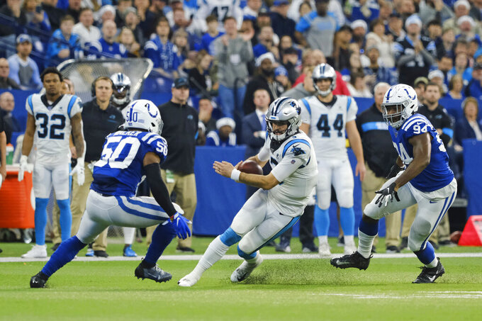 Carolina Panthers quarterback Will Grier (3) is tackled by Indianapolis Colts' Anthony Walker (50) and Tyquan Lewis (94) during the first half of an NFL football game, Sunday, Dec. 22, 2019, in Indianapolis. (AP Photo/AJ Mast)