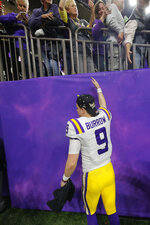 LSU quarterback Joe Burrow leaves the field after a NCAA College Football Playoff national championship game against Clemson, Monday, Jan. 13, 2020, in New Orleans. LSU won 42-25. (AP Photo/Gerald Herbert)