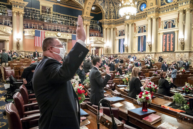 First term legislators of the Pennsylvania House of Representatives are sworn-in, Tuesday, Jan. 5, 2021, at the state Capitol in Harrisburg, Pa. The ceremony marks the convening of the 2021-2022 legislative session of the General Assembly of Pennsylvania. (AP Photo/Laurence Kesterson)