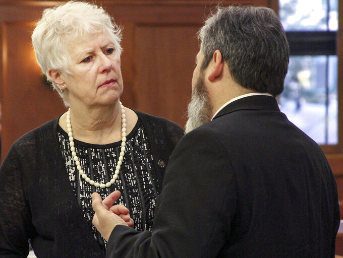FILE - In this Jan. 16, 2018, file photo, Alaska state Rep. Louise Stutes, left, a Kodiak Republican, speaks with Rep. Sam Kito III, a Juneau Democrat, before the start of the Alaska legislative session at the Alaska State Capitol in Juneau, Alaska. The Alaska House voted to elect Kodiak Rep. Louise Stutes as speaker Thursday, Feb. 11, 2021, more than three weeks into the legislative session. Rep. Stutes, following her election, said she looked forward to uniting the 40-member House. (AP Photo/Mark Thiessen, File)
