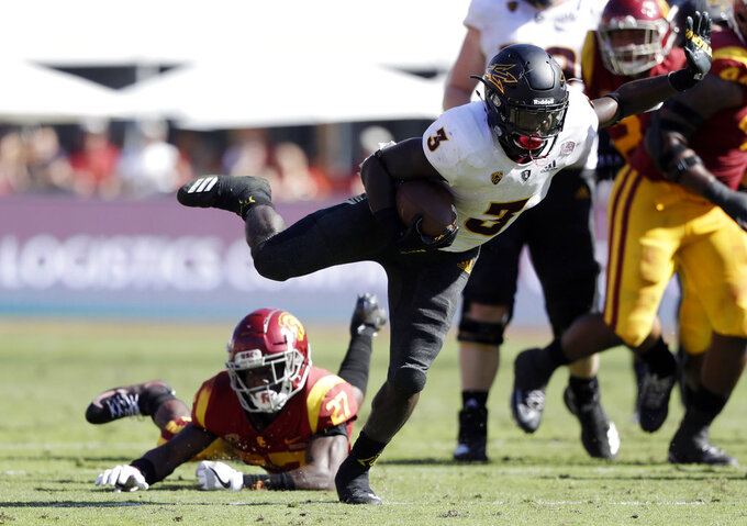 Arizona State running back Eno Benjamin (3) runs for a touchdown past Southern California cornerback Ajene Harris, bottom left, during the first half of an NCAA college football game Saturday, Oct. 27, 2018, in Los Angeles. (AP Photo/Marcio Jose Sanchez)