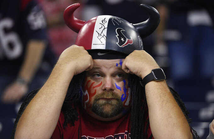 A fan watches as the Houston Texans fall to the Indianapolis Colts in an NFL wild card playoff football game, Saturday, Jan. 5, 2019, in Houston. (AP Photo/Eric Christian Smith)