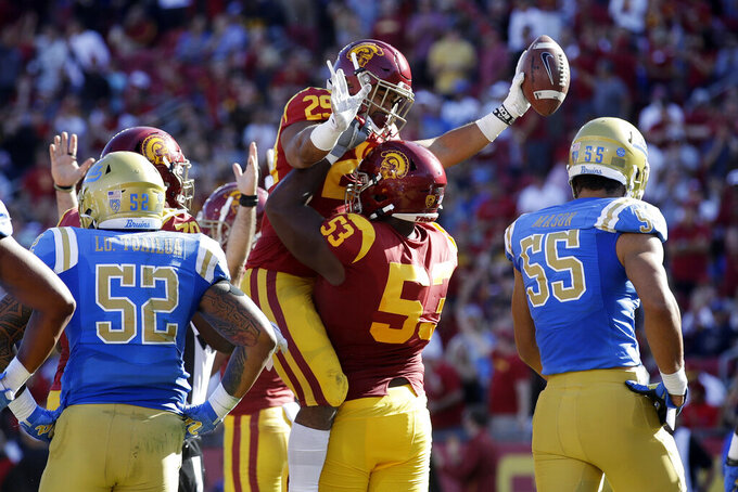 Southern California running back Vavae Malepeai (29) celebrates his rushing touchdown with linebacker Bryce Matthews (53) during the first half of an NCAA college football game against UCLA, Saturday, Nov. 23, 2019, in Los Angeles. (AP Photo/Marcio Jose Sanchez)