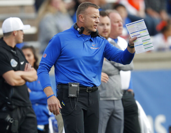 Boise State head coach Bryan Harsin directs his team against Air Force in the first half of an NCAA college football game Saturday, Oct. 27, 2018, at Air Force Academy, Colo. (AP Photo/David Zalubowski)