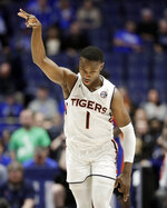 Auburn guard Jared Harper celebrates after making a 3-point basket against Florida in the first half of an NCAA college basketball game at the Southeastern Conference tournament Saturday, March 16, 2019, in Nashville, Tenn. (AP Photo/Mark Humphrey)