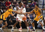 Arizona State's Jaelen House, left, knocks the ball from St. John's Mustapha Heron, center, as Arizona State's Rob Edwards, right, defends during the first half of an NCAA college basketball game, Saturday, Nov. 23, 2019, in Uncasville, Conn. (AP Photo/Jessica Hill)