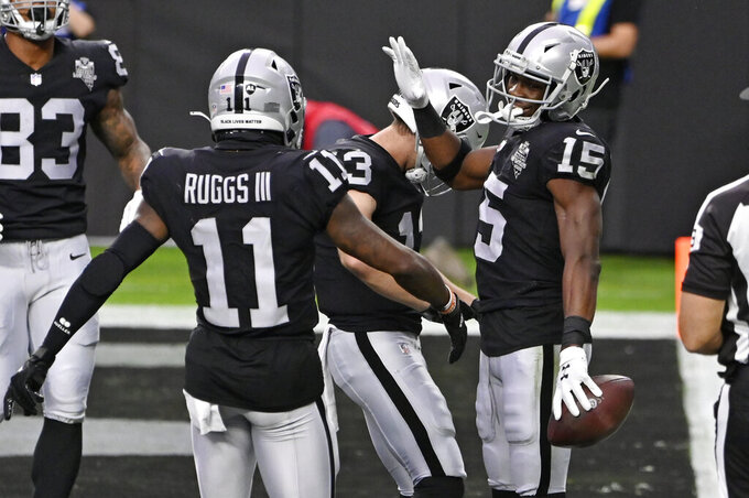 Las Vegas Raiders wide receiver Henry Ruggs III (11) celebrates after wide receiver Nelson Agholor (15) scored a touchdown against the Indianapolis Colts during the first half of an NFL football game, Sunday, Dec. 13, 2020, in Las Vegas. (AP Photo/David Becker)